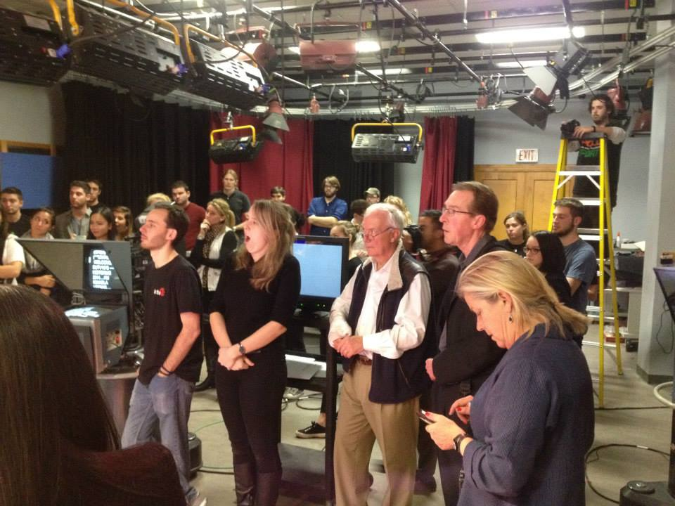 The large production team watches live coverage at the National Desk.