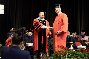 Freeman G. Corkum receives his award at MET commencement.