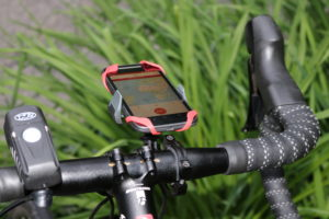 Tackform cell phone holder and NiteRider light